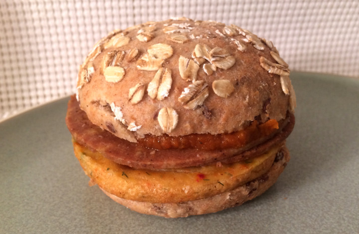 Sweet Earth Harmless Ham, Vegan Chickpea Patty, and Sun-Dried Tomato Farmstand Breakfast Sandwich