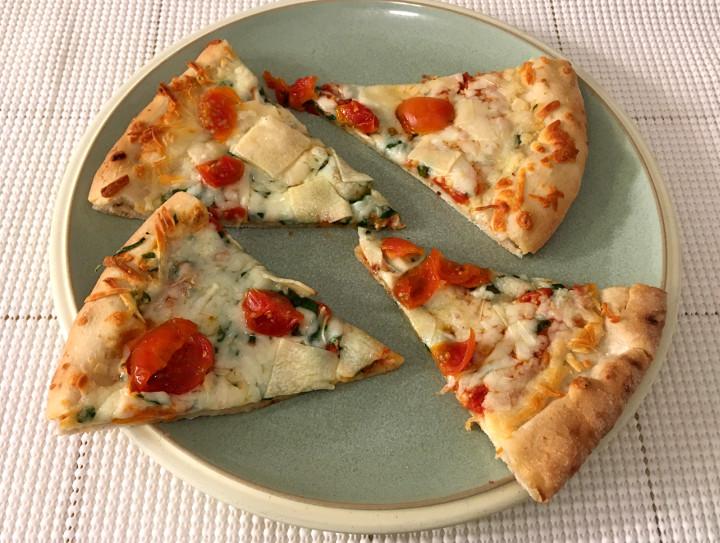 Trader Giotto's Arugula Pizza with Cherry Tomatoes, Mozzarella, Manchego, Provolone & Pecorino Cheese